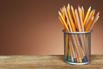 Many pencils in metal holder