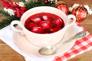 Traditional polish clear red borscht with dumplings and