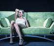 Beautiful girl laying on the sofa in deep thinking