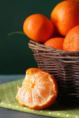 Fresh ripe mandarins in wicker basket,