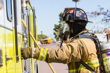 Firefighter Boarding Fire Engine