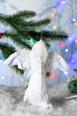 Christmas handmade decoration hanging on blurred background