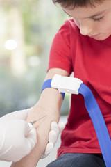 Kid on blood sampling