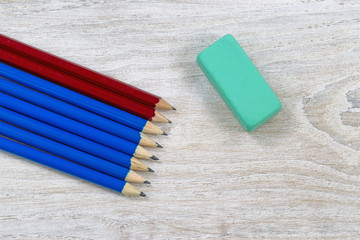 Pencils and large single Eraser on Wood