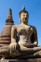 old buddha statue and stupa