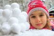 Girl and snowballs