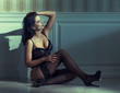 Sensual woman sit on floor at night