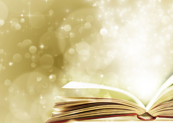 Christmas background with opened magic book