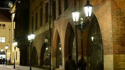 night urban street with people - lamps in row