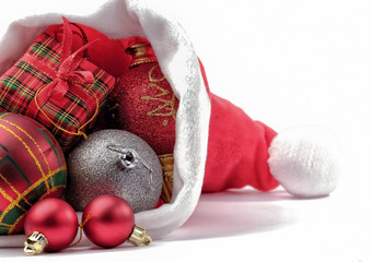 Christmas hat with Christmas decorations isolated on white
