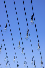 Light bulbs against the blue sky