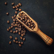 Coffee beans and an old wooden scoop