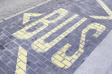 Bus signal on asphalt