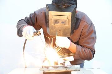 worker welding steel .