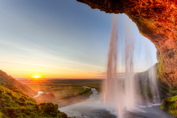 Seljalandsfoss Waterfall at sunset, Iceland © ronnybas