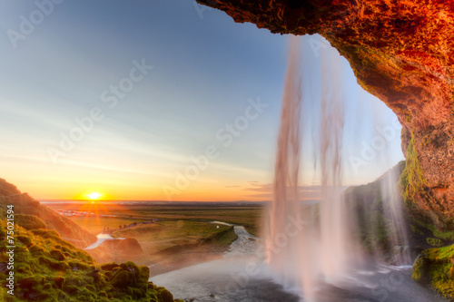 Poster Watervallen Seljalandsfoss Waterfall at sunset, Iceland