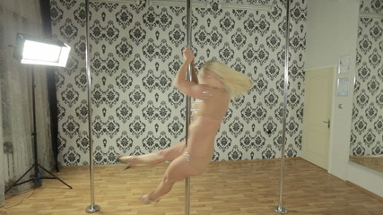 Beautiful sexy girl performing dance on pole