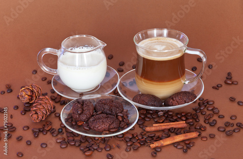 A cup of latte coffee with milk and cookies