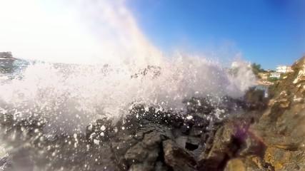 Water splashing against rocks, slow motion