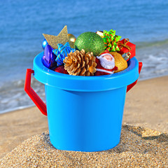 Baby bucket with gifts and Christmas decorations