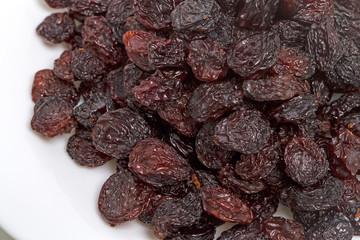 Raisins on a white plate