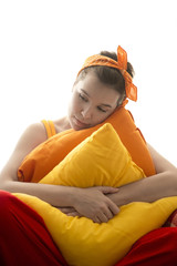 sad lonely girl hugging pillows