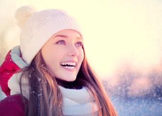 Beauty winter girl outdoors in frosty winter park