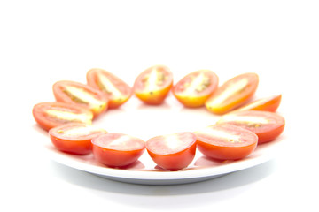 Mini tomato cross section sliced on white plate