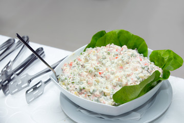 Russian salad in white plate