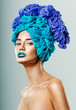 Beautiful woman with hair made of threads for knitting. Professi