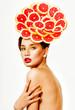 Beautiful woman with grapefruit slices. Citrus. Perfect skin. Pr