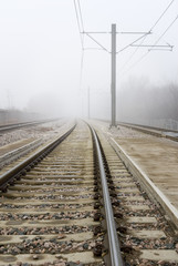 Train Tracks Disappear Into Fog