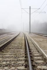 Train Tracks Disappear Into Fog