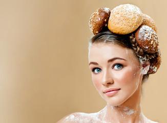 Beautiful woman with fresh fragrant bread. Crispy rolls. Bread B
