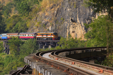 thai trains running on death railways crossing kwai river in kan