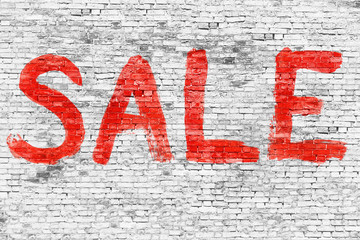 Sale word painted over brick wall