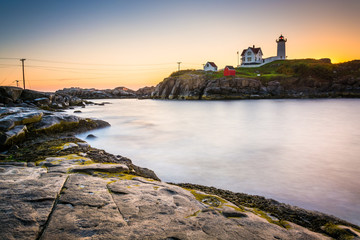 Long exposure of the Atlantic Ocean and Nubble Lighthouse at sun
