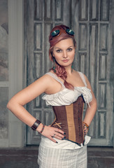 Beautiful steampunk woman with pink hair