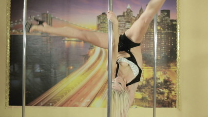Girl performs different tricks on pole