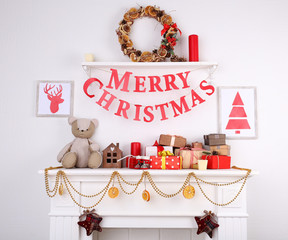 "Decorated Christmas fireplace with inscription ""Merry"