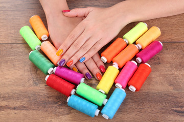 Multicolor female manicure with colorful thread