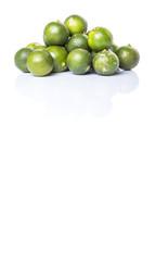 Calamondin or calamansi lime over white background