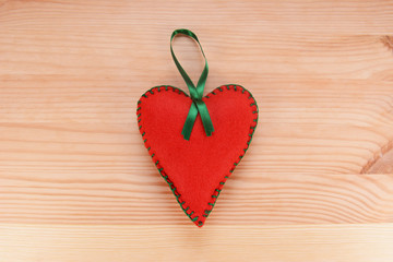 Red felt heart ornament with green ribbon