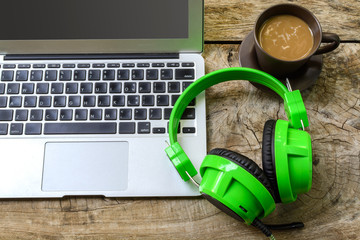 Cup of coffee with laptop and headphone
