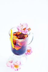 flowers and mulled wine in glass