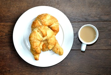 Top view of croissants and coffee