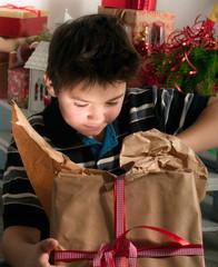 boy unpacks a gift