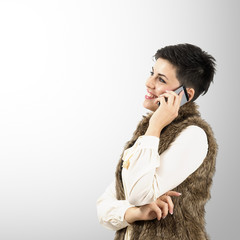 Portrait of smiling woman on the mobile phone