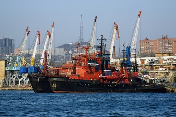 Red-black ships and harbour cranes in Vladivostok, Russia