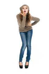 Charming young brown-haired woman in a full-length sweater blows